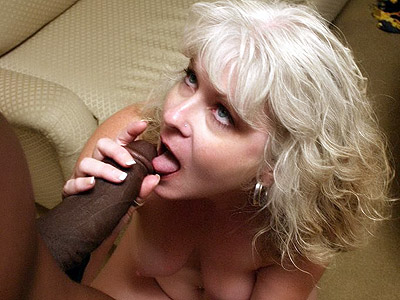 Lusty mom lest a black hunk munch on her pussy