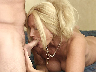 Blonde and large chested MILF Roxy pleases a well hung stud with a wet and deep cock munching