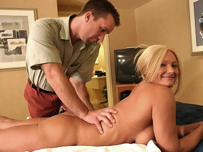 Naughty milf Roxy enjoys a good massage then rides her masseuse like a naughty cowgirl