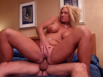 MILF Roxy exposes her sexy ass while riding a cock and taking it doggy style in bed